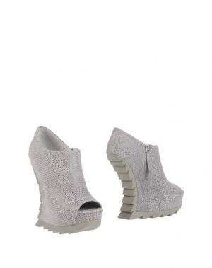 Полусапоги и высокие ботинки CAMILLA SKOVGAARD. Цвет: серый