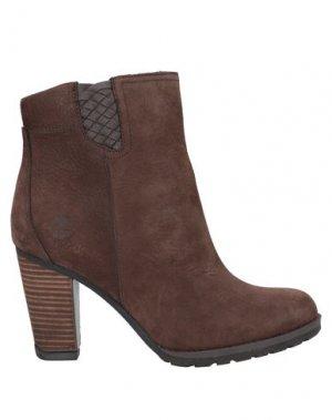 Полусапоги и высокие ботинки TIMBERLAND. Цвет: коричневый