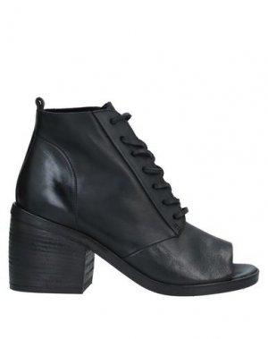 Полусапоги и высокие ботинки MARSÈLL. Цвет: черный