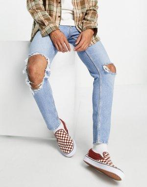 Светло-голубые выбеленные эластичные джинсы облегающего кроя в винтажном стиле со рваной отделкой на коленях -Голубой ASOS DESIGN