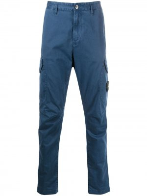 Зауженные брюки карго Stone Island. Цвет: синий