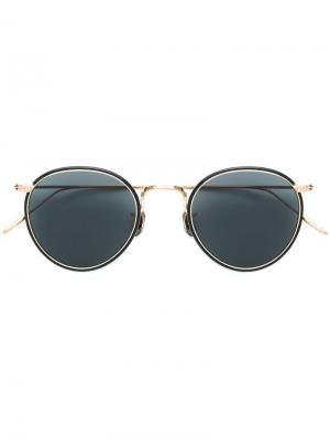 Солнцезащитные очки в круглой оправе с поляризованными стеклами Eyevan7285. Цвет: золотистый