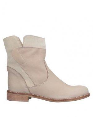 Полусапоги и высокие ботинки SANDRO FERRONE. Цвет: бежевый