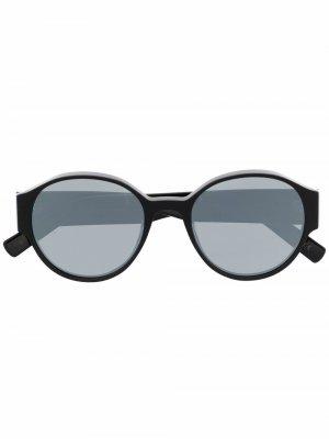 Солнцезащитные очки в круглой оправе с логотипом Christian Roth. Цвет: 82 черный