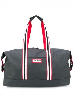 Дорожная сумка с нашивкой-логотипом Hunter. Цвет: черный