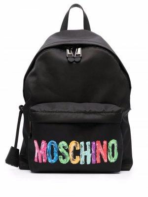 Рюкзак с логотипом Moschino. Цвет: черный