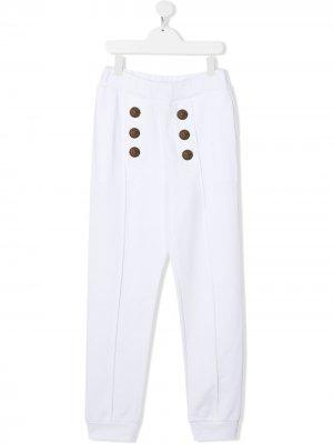 TEEN embossed-button trousers Balmain Kids. Цвет: белый