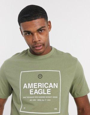 Футболка оливкового цвета с логотипом на груди и фотографическим принтом спине -Зеленый цвет American Eagle