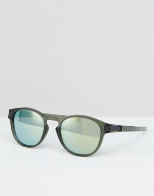 Солнцезащитные очки в круглой оправе с синими зеркальными стеклами Oak Oakley. Цвет: зеленый