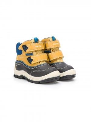 Зимние ботинки со вставками Geox Kids. Цвет: желтый