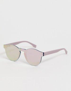 Круглые солнцезащитные очки Lacoste