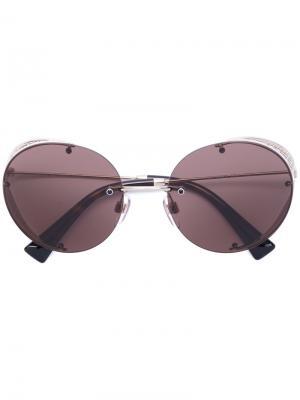 Солнцезащитные очки в круглой оправе Valentino Eyewear. Цвет: металлический