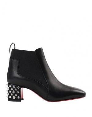 Полусапоги и высокие ботинки CHRISTIAN LOUBOUTIN. Цвет: черный