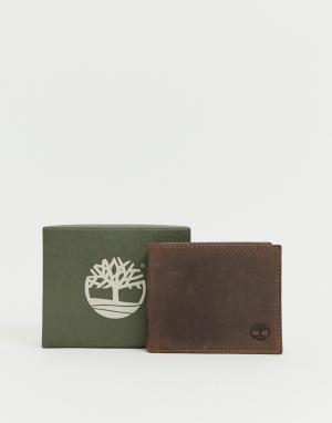 Темно-коричневый бумажник с отделением для монет Timberland. Цвет: коричневый