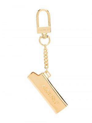 Брелок в виде чехла для зажигалки с тисненым логотипом AMBUSH. Цвет: золотистый