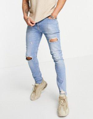 Синие выбеленные зауженные джинсы в винтажном стиле с рваной отделкой и потертостями -Голубой ASOS DESIGN