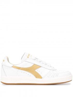 B. кроссовки Elite Diadora. Цвет: белый
