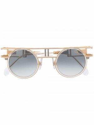 Солнцезащитные очки Mod 668 в круглой оправе Cazal. Цвет: золотистый