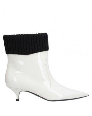 Полусапоги и высокие ботинки DIOR. Цвет: белый
