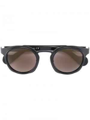 Солнцезащитные очки в круглой оправе Moncler. Цвет: чёрный