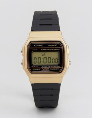 Черно-золотистые цифровые часы с силиконовым ремешком F91WM-9A-Черный Casio