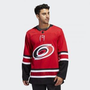 Оригинальный хоккейный свитер Hurricanes Home Performance adidas. Цвет: красный