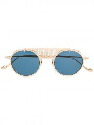 Солнцезащитные очки в круглой оправе Matsuda. Цвет: золотистый