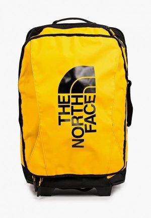 Чемодан The North Face cabin size. Цвет: желтый