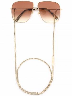 Солнцезащитные очки GV с эффектом градиента Givenchy Eyewear. Цвет: золотистый