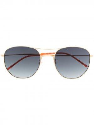 Солнцезащитные очки в круглой оправе Tommy Hilfiger. Цвет: золотистый