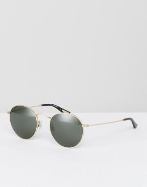 Круглые солнцезащитные очки в золотистой оправе Levis. Цвет: золотой