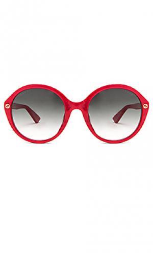 Солнцезащитные очки с круглой оправой из ацетата Gucci. Цвет: красный