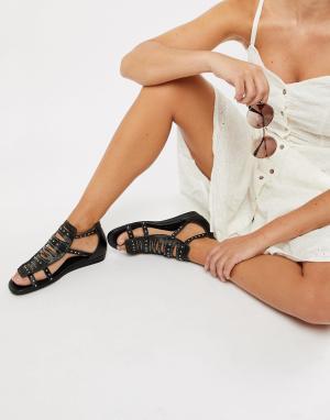 Сандалии с ремешками и заклепками Sofie Schnoor. Цвет: черный