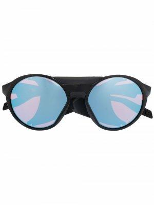 Солнцезащитные очки в круглой оправе Oakley. Цвет: черный