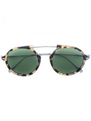 Солнцезащитные очки в круглой оправе Tod's. Цвет: коричневый