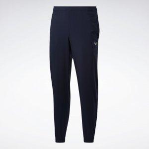 Спортивные брюки Training Essentials Woven Cuffed Reebok. Цвет: vector navy