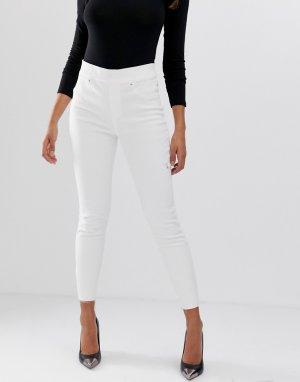Моделирующие джинсы скинни с рваной отделкой -Белый Spanx