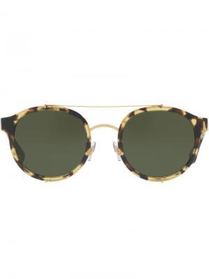 Солнцезащитные очки в круглой оправе Dolce & Gabbana Eyewear. Цвет: желтый