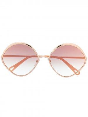 Солнцезащитные очки в овальной оправе Chloé Eyewear. Цвет: золотистый