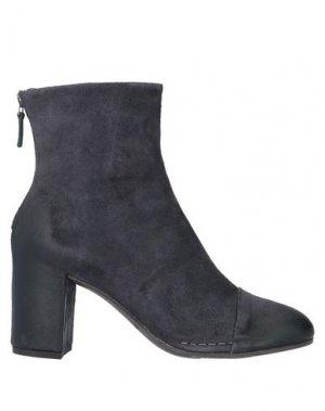 Полусапоги и высокие ботинки ROBERTO DEL CARLO. Цвет: темно-синий