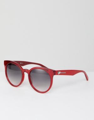 Красные круглые солнцезащитные очки LOVE Moschino. Цвет: красный