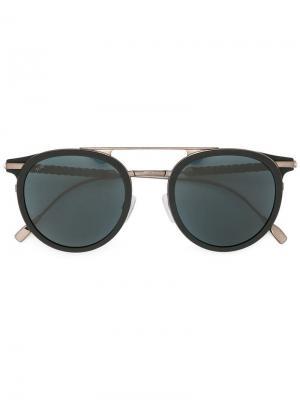 Затемненные солнцезащитные очки в круглой оправе Tod's. Цвет: черный