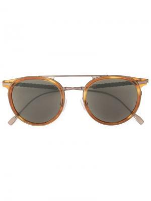 Затемненные солнцезащитные очки в круглой оправе Tod's. Цвет: коричневый