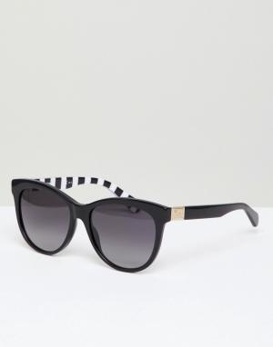 Черные круглые солнцезащитные очки LOVE Moschino. Цвет: черный