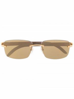 Солнцезащитные очки в безободковой оправе Cartier Eyewear. Цвет: коричневый