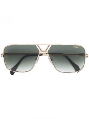 Затемненные солнцезащитные очки в квадратной оправе Cazal. Цвет: золотистый