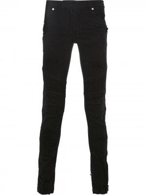 Байкерские джинсы с рваными деталями Balmain. Цвет: черный