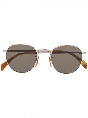 Солнцезащитные очки в круглой оправе Eyewear by David Beckham. Цвет: серебристый