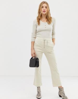 Расклешенные брюки цвета слоновой кости с двумя молниями -Кремовый ASOS DESIGN