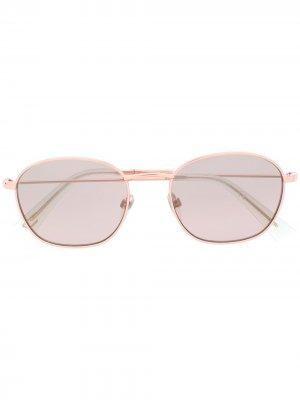 Солнцезащитные очки в круглой оправе с затемненными линзами Diesel. Цвет: золотистый